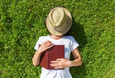woman resting in a field